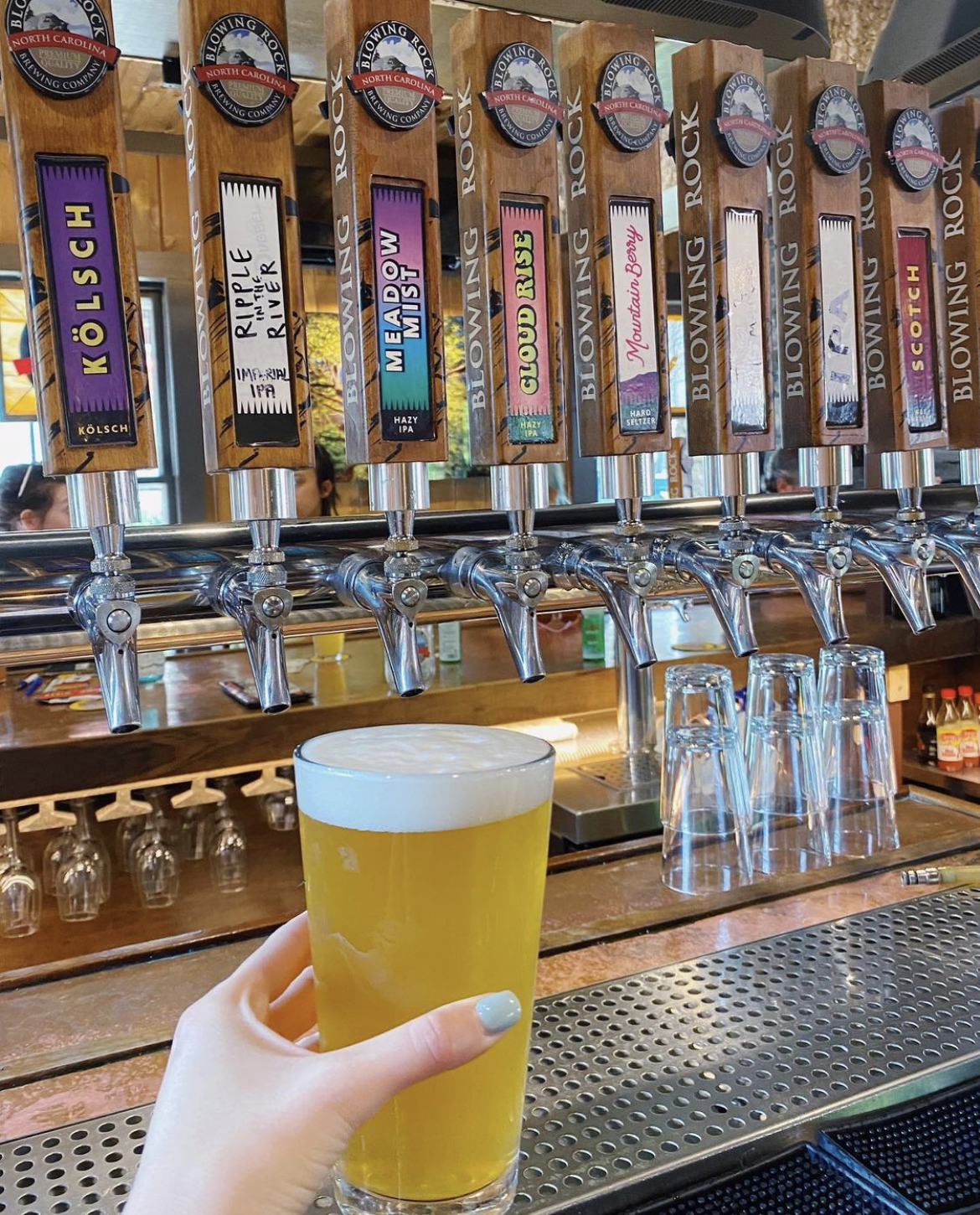 Fresh beer from taps at Blowing Rock Brewing Co