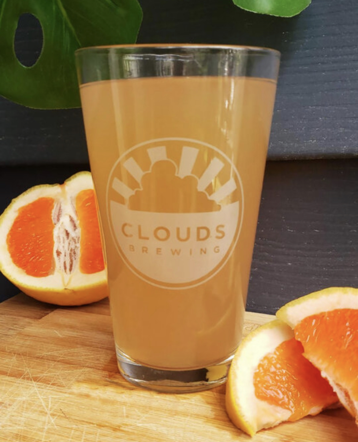 Clouds brewing beer shot with oranges